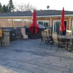 Courtyard with retaining wall and privacy fence