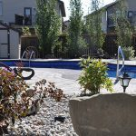 Complete landscaping job involving a pool, pavers, fencing, retaining walls, and arbor